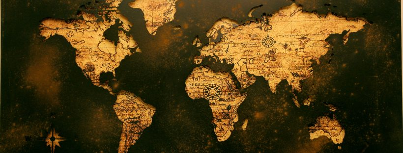 dark sheet metal with cutouts over the continents lining up with a world map.